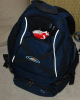 This is a camera bag that is a backpack for a large digital camera and all of the corresponding gear