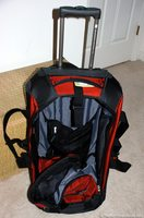 Our rolling duffel tech bag with tons of space and lots of compartments